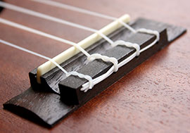 a ukulele bridge properly strung